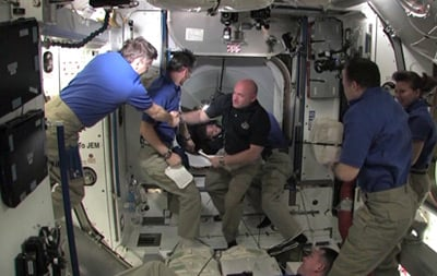 Endeavour crew welcomed aboard the ISS. Pic: NASA TV