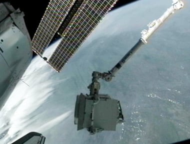 The ISS's robotic arm grapples the AMS. Pic: NASA TV