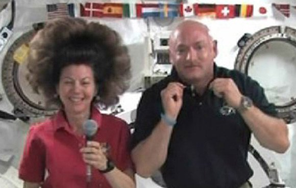 Cady Coleman's unfettered zero-grav hairstyle seen in during an interview with Endeavour commander Mark Kelly. Pic: NASA TV