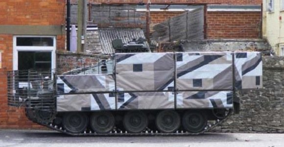 A Spartan armoured vehicle equipped with TARIAN textile protection in 'Dazzle' pattern. credit: DSTL