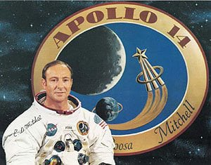 Edgar Mitchell with the Apollo 14 logo