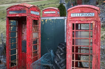 Decaying red telephone boxes