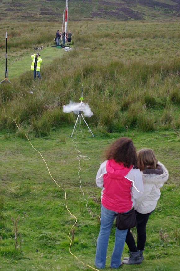 A mother and daughter team launch a rocket