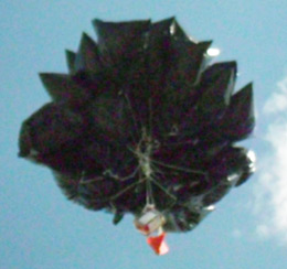 Trash bag cluster on weather balloon gps tracker