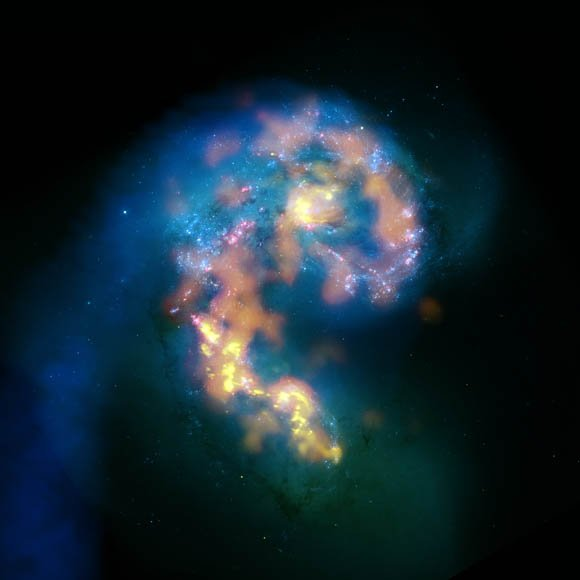 Clouds of gas and dust at the Antennae Galaxies' impact zone, 45 million light-years away