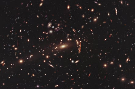 Hubble photo showing gravitational lensing warping the appearance of the galaxy cluster MACS J1206.2-0847