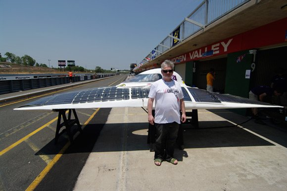 Drew poses in front of Durham Uni's solar car