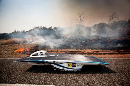Nuon's Nuna6 drives by a bush fire: Pic: Nuon