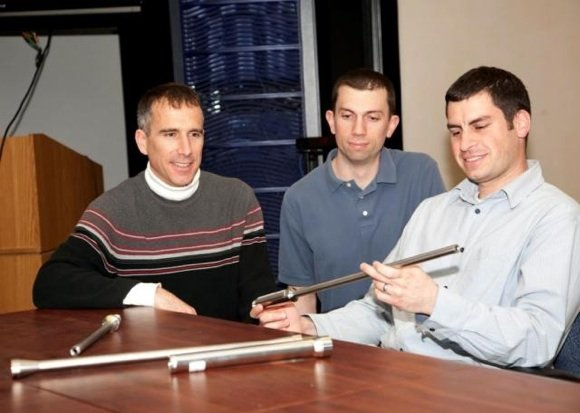 Picatinny engineer Vinny Leto (right) holds one of the cobalt alloy barrels produced using the flow forming technique. Credit: US Army