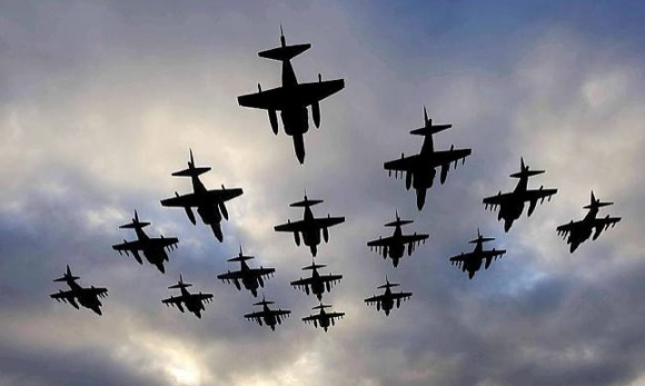 Harrier GR9s in a formation flypast to mark the type's departure from British service. Credit: Crown Copyright/Jamie Hunter