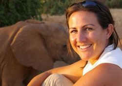 British biologist, Dr Lucy E King and an elephant
