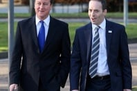 Prime Minister David Cameron arrives alongside BT CEO Ian Livingstone (right) at Adastral Park, BT's global innovation and development centre in Ipswich, Suffolk