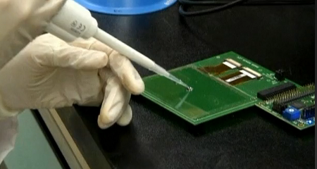 Drop being placed on a touch-screen for analysis