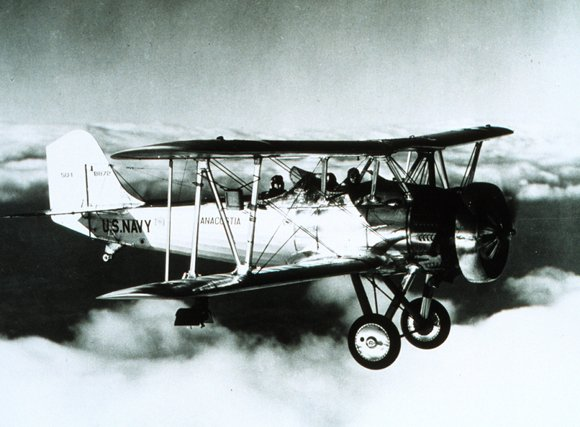 US Navy biplane in flight in December 1934