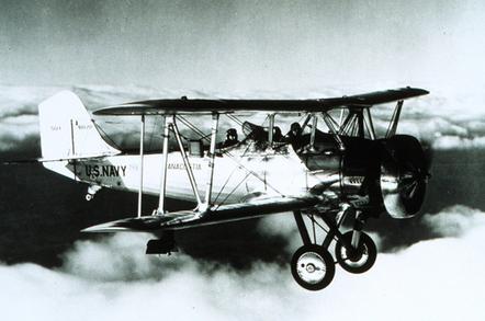 US Navy biplane in flight in December 1934
