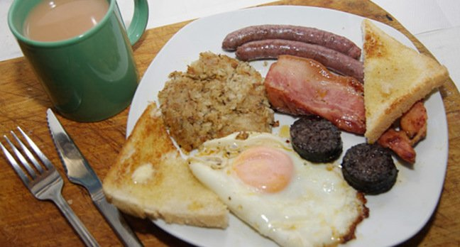 The full Spanglish breakfast: mealy pudding, bacon, black pudding, sausages, fried egg, toast