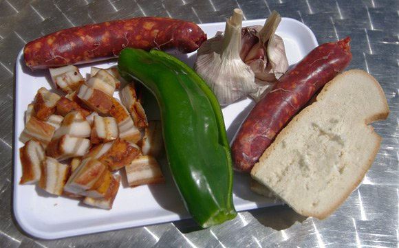 Panceta, chorizo, pepper, garlic and bread - the basic ingredients of migas