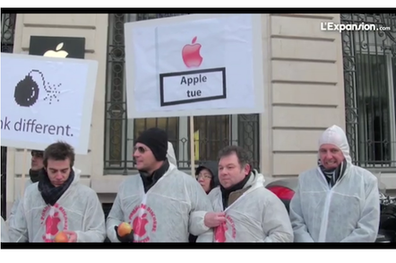 Resellers protest outside an Apple store in France, credit screengrab Express video