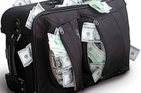 Suitcase bulging with cash