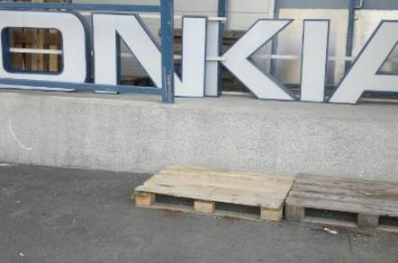 Nokia sign dismantled, with letters rearranged to spell 'ONKIA'