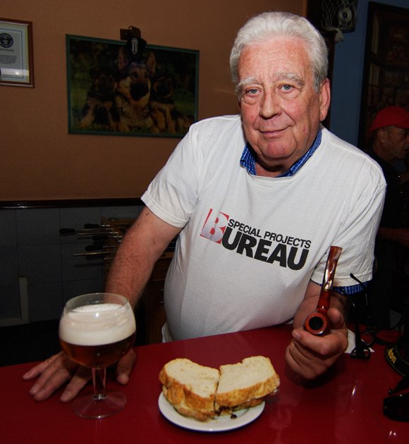 Jose Maria Pita with bacon sarnie and beer