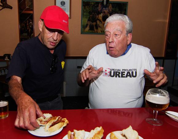 Alvaro and Jose Maria Pita attack a bacon sarnie