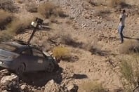 A still showing the crashed Street View car in a rocky gorge