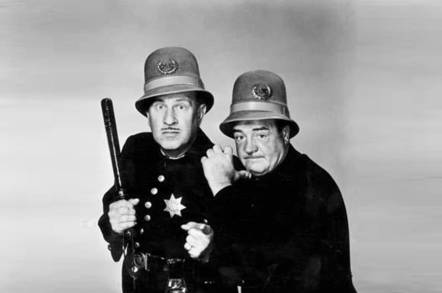 Abbott and Costello dressed as policemen
