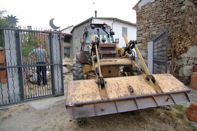 Ramon and the excavator trundle through the gates