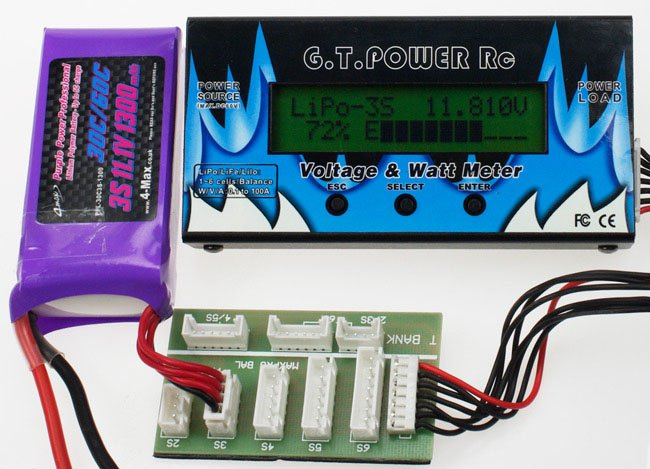 The LiPo connected to the meter, which is showing voltage and charge capacity