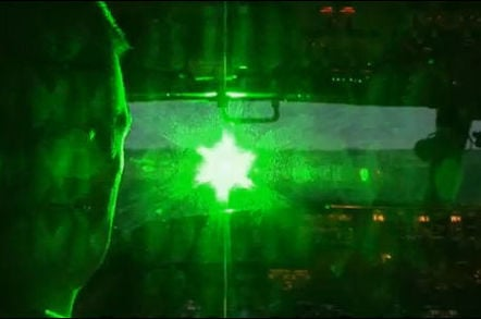 Simulated photo of a green laser striking an aircraft cockpit