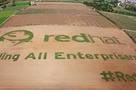 "Giant Red Hat shadowman logo in field, with message, ""Calling all enterprisers"""