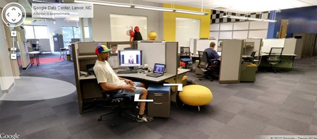 Bloke sitting at computer in Google data centre
