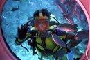Diver peers through sub window. credit: Alexander Rist  http://www.sxc.hu/profile/OwnMoment