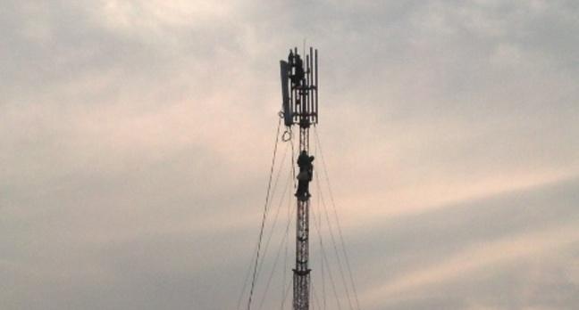 Engineers fitting antenna heads