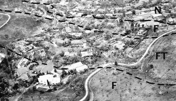 A photograph of the Canberra suburb of Chapman showing the path of a fire tornado