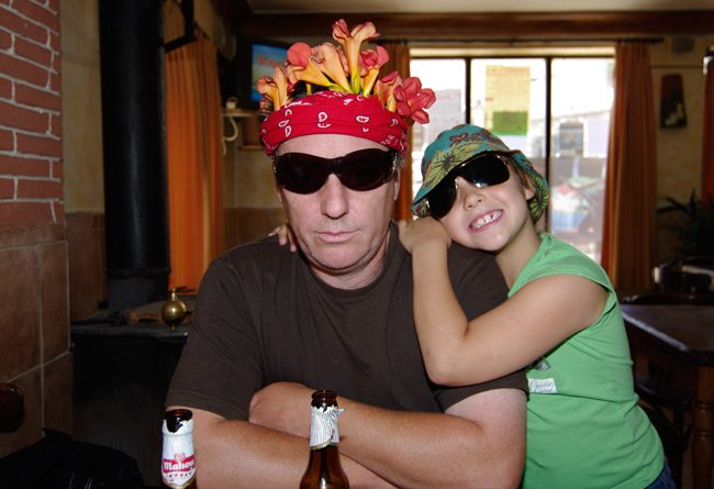 Me in local bar with my daughter, in exotic headdress