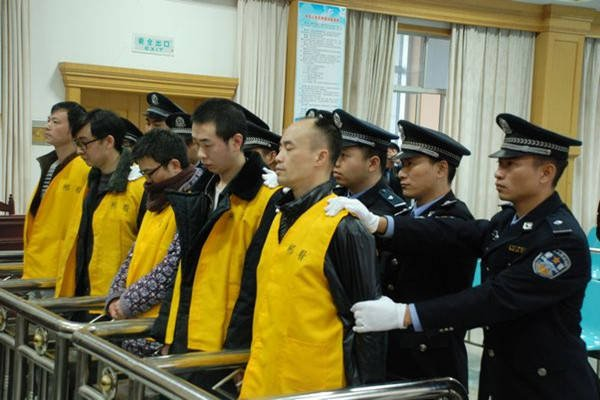 Photo of defendants in Chinese kidney-for-iPhone scheme