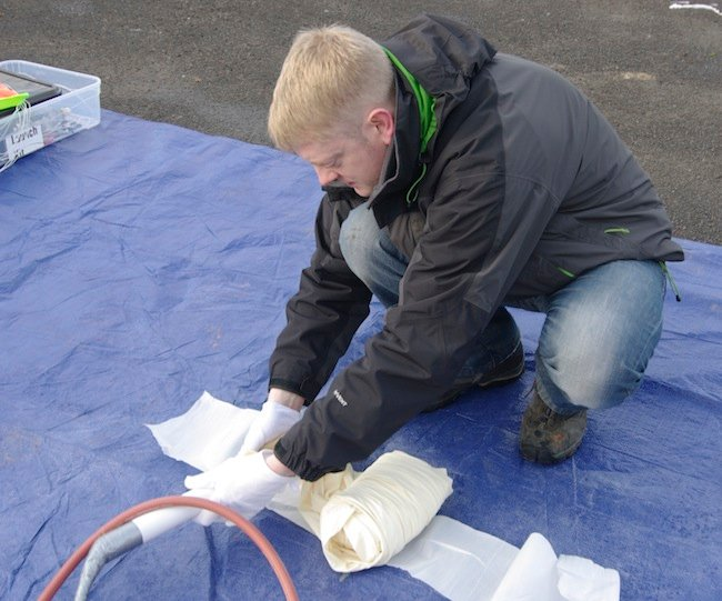 Anthony preps the balloon nozzle for filling