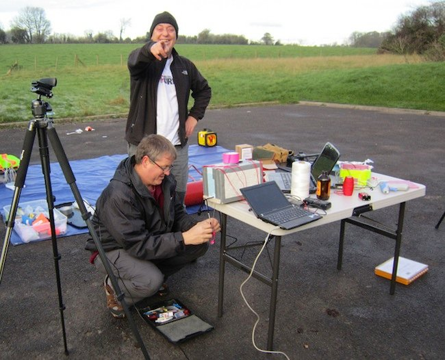 Lester laughing at Dave backing away as he takes a snap of the igniter connection