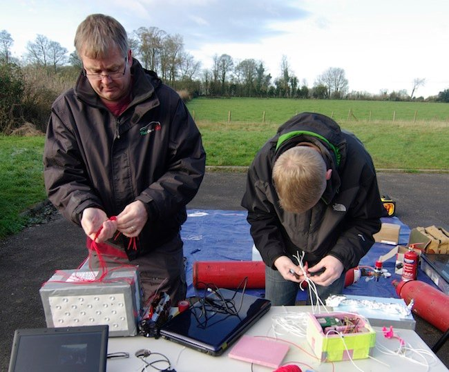 Neil and Anthony prepare the payload