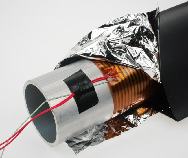 The aluminium tube wrapped with the heater, space blanket and heatshrink, prior to heating