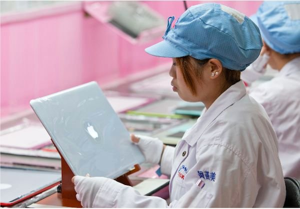 A worker in Apple's supply chain, photo credit Apple, from the Supplier Responsibility Report 2013
