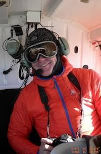 Richard Youd in a helicopter near Davis Station. Photo Copyright Phill O'Brien.