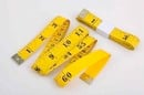 yellow measuring tape - black writing