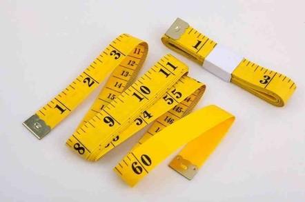yellow measuring tape - black writing
