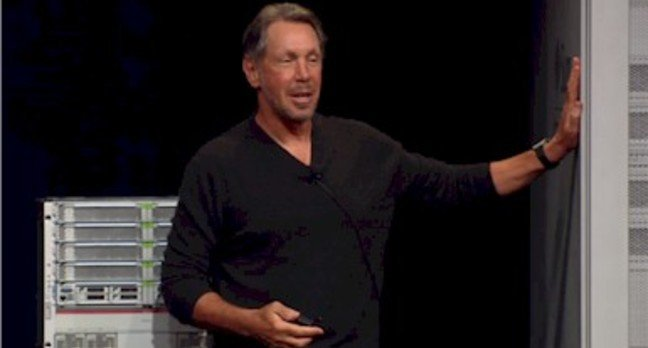 Larry Ellison lovingly pats his first Oracle mainframe