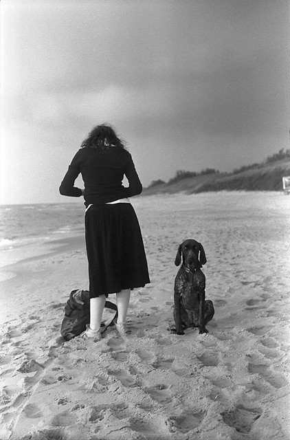 A girl and a dog, photo by Andrej Vasilenko