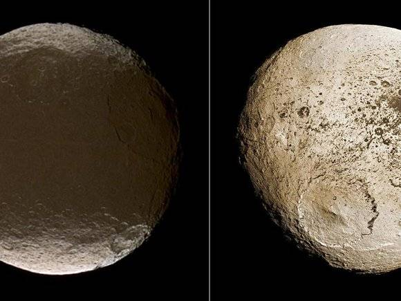 Extreme brightness dichotomy on the surface of Saturn moon Iapetus