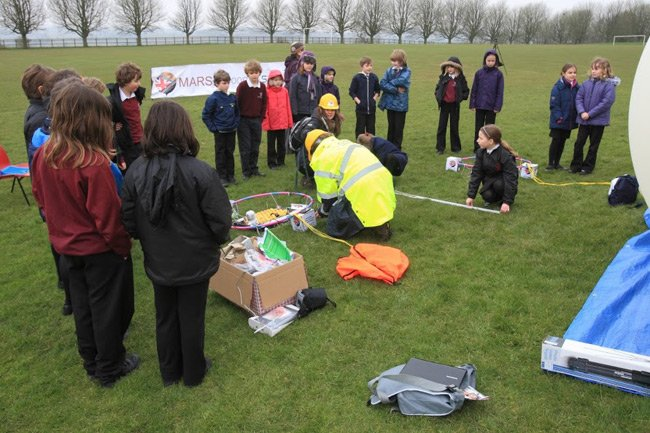 SEA operatives prep the mission while schoolkids look on. Pic: SEA